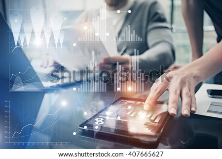 Photo female hands touching screen modern tablet.Account manager working new investment project in global bank.Using electronic devices. Graphics icons, worldwide stock exchanges interface. Horizontal - stock photo