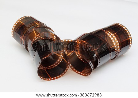 Photo-film with white background in roll shape - stock photo