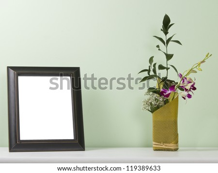 photo frame and flowers on the table - stock photo