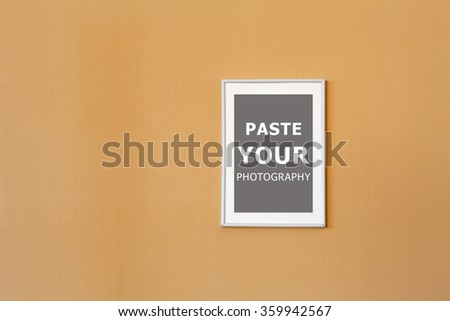 Photo frame on the wall in the living room. Paste your photo. - stock photo