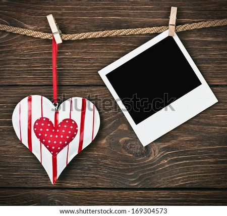 Photo Frame with heart and place for congratulations Valentine (birthday, wedding, etc.) - stock photo