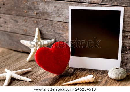 Photo frames and valentines day  heart over wooden background.Clipping path for insert Photo - stock photo