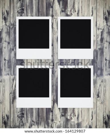 Photo frames on grunge wood - stock photo