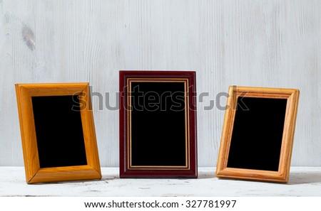 photo frames on old white table - stock photo