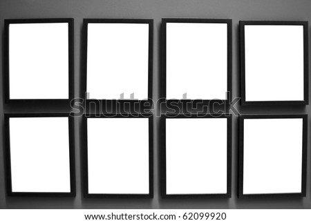 Photo frames on wall - stock photo