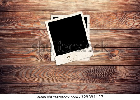 photo frames on wooden background - stock photo