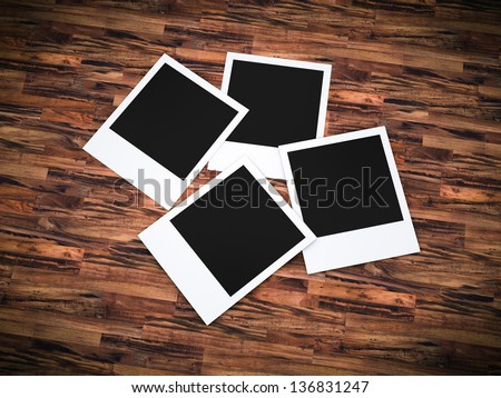 Photo frames over wood - stock photo