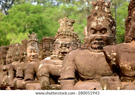 Photo from Angkor Wat world heritage site, Row of Giant statue at entrance of Angkor Wat Cambodia  - stock photo