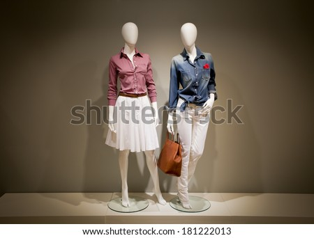 Photo full-length female clothes on a two mannequin with bag - stock photo