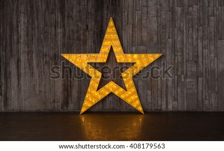 Photo gold star with lights on the background of dark scenes - stock photo