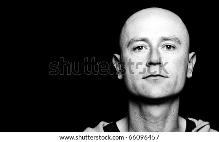 photo high contrast dark moody capture of a midde age male on black screen - stock photo