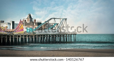 Photo Illustration of Seaside Heights NJ Amusement Park. This original roller coaster no longer exists due to Hurricane Sandy - stock photo