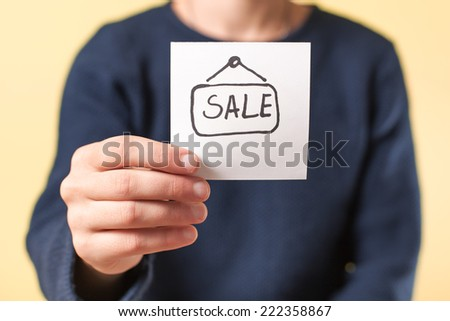 Photo image of a sale graph in hand - stock photo