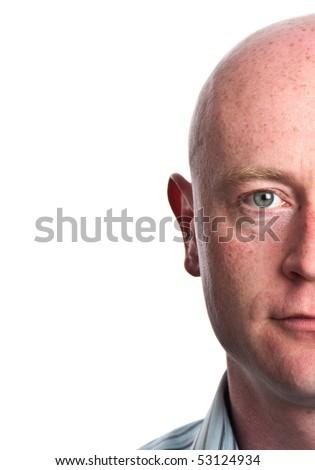 photo male face half bald isolated portrait close up on white backdrop - stock photo