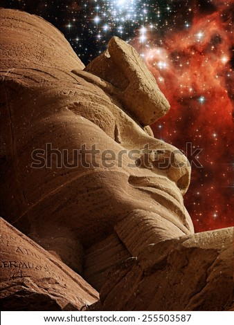 Photo-montage of a Ramses II statue at Abu-Simbel and Star Cluster Bursts NGC3603 (Elements of this image furnished by NASA) - stock photo