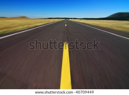 photo motion capture empty highway road along the grand canyon - stock photo