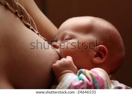 Photo of a baby breast feeding. - stock photo