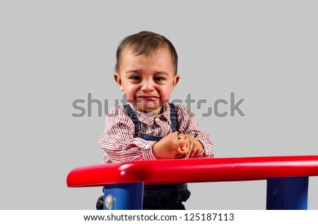 photo of a baby crying in the nursery in gray - stock photo