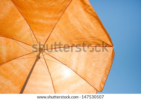 Photo of a beach umbrella on the blue sky,Beach umbrella - stock photo