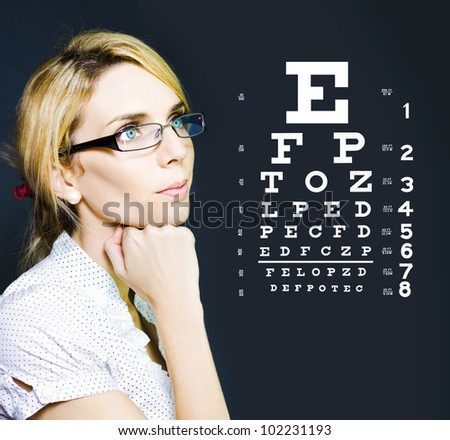 Photo Of A Beautiful Blonde Business Optician Or Optometrist Wearing Eye Wear Glasses Looking At Number And Letters On A Ophthalmology Chart To Check Eyesight - stock photo