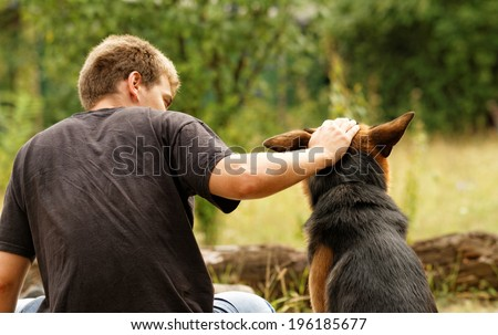 Photo of a beautiful friendship with a boy and a dog - stock photo