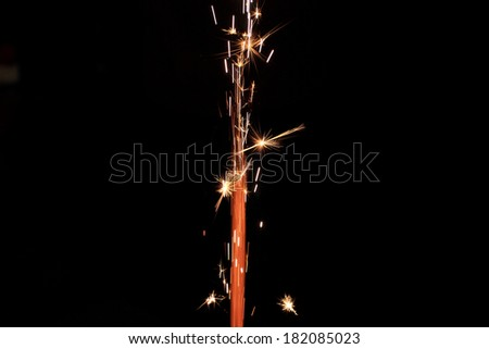Photo of a beautiful orange fireworks at night - stock photo