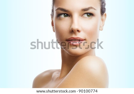Photo of a beautiful woman against blue gradient background - stock photo