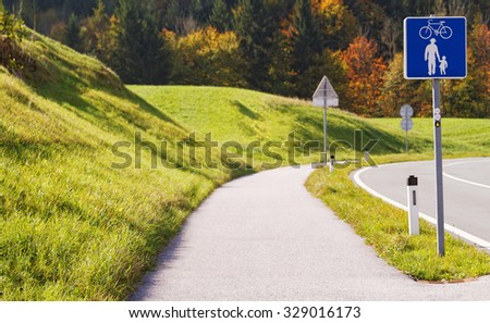 Photo of a bicycle path out of the city  - stock photo