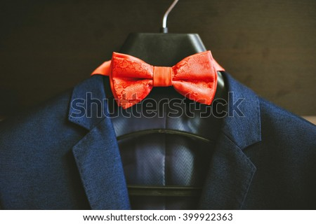 Photo of a blue suit with white shirt and red tie. - stock photo