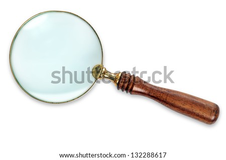 Photo of a Brass Magnifying Glass with wooden handle, isolated on white background with clipping path for both the outline and internal glass area. - stock photo