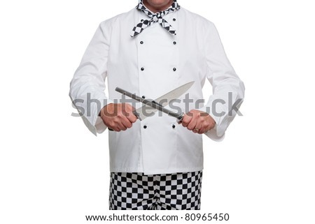 Photo of a chef in uniform sharpening his carving knife isolated on a white background. - stock photo
