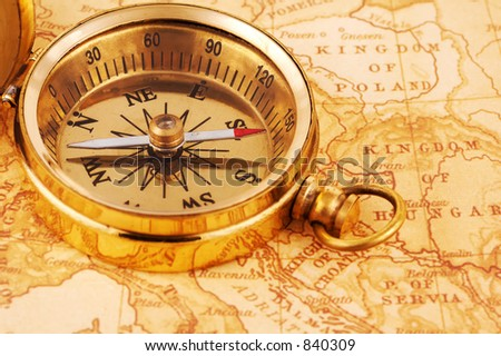 Photo of a Compass on a Map - stock photo