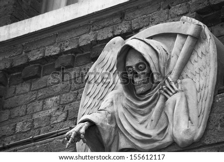 photo of a death statue outside the London Dungeon, UK - stock photo