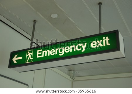 photo of a emergency sign at a international airport - stock photo