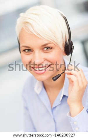 photo of a female assistant with headphones - stock photo