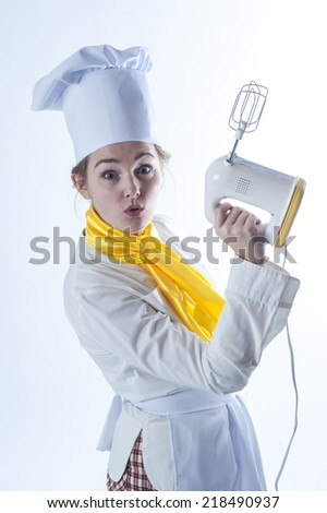 Photo of a funny cook with mixer. - stock photo