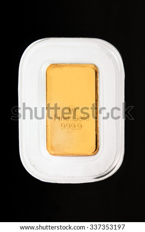 photo of a 1g gold bar isolated on a black background - stock photo