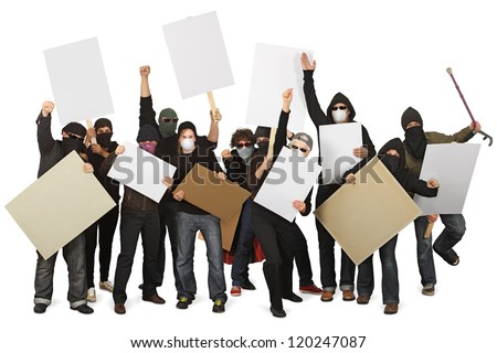 Photo of a group of unrecognizable protesters wearing masks and holdings signs. - stock photo