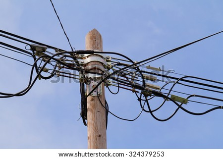 Photo of a high pylon with blue sky background - stock photo