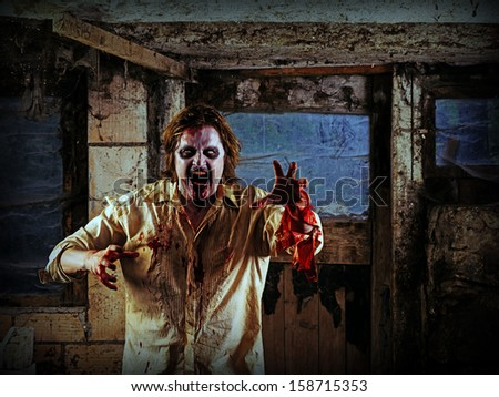 Photo of a hungry zombie about to attack you.  - stock photo