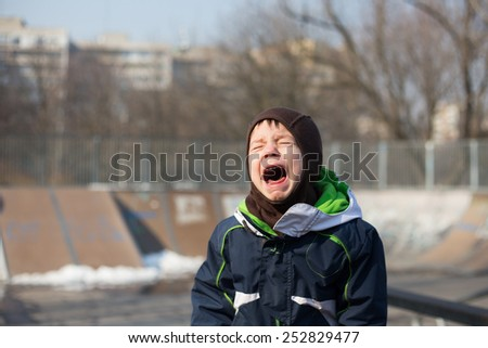 photo of a kid crying very loud in a temper tantrum - stock photo