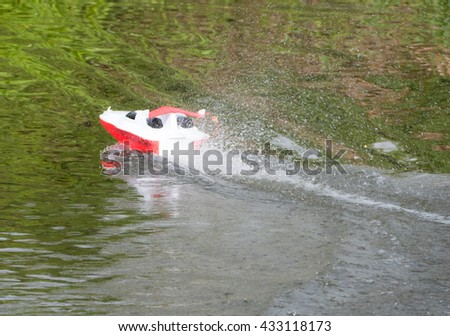 Photo of a kids radio controlled boat - stock photo