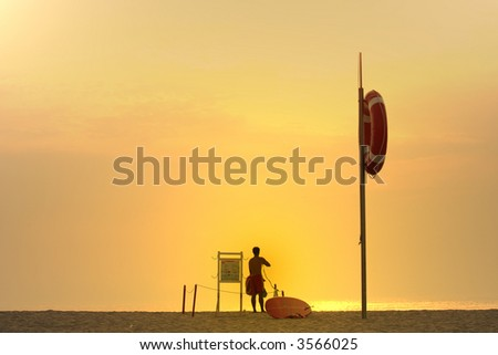 photo of a lifesaver at sunset - stock photo