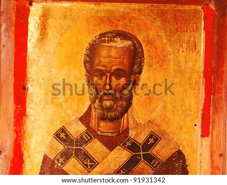 photo of a miracle icon St Nicholas , from 14 th century - stock photo