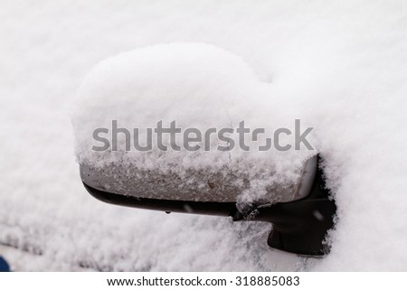 Photo of a snowy car's rearview mirror - stock photo
