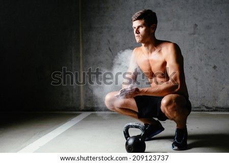 Photo of a sportsman spreading talc over his  palms - stock photo