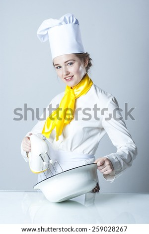 Photo of a young cook working with mixer - stock photo