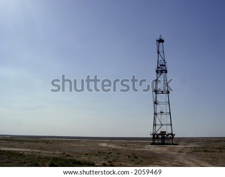 Photo of abandoned oil rig in steppe of Middle Asia - stock photo