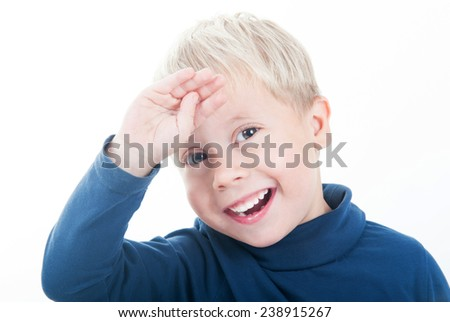 Photo of adorable young happy boy on a white background - stock photo