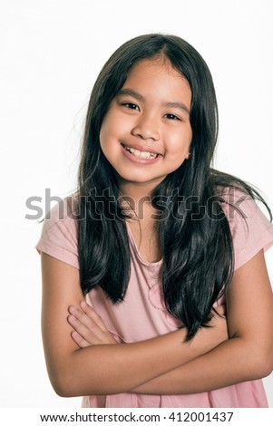 Photo of adorable young happy girl ,dreadlocks hair style, looking at camera. ,Isolated  - stock photo